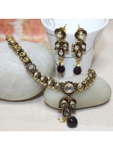 https://static1.cilory.com/31636-thickbox_default/elegant-polki-work-necklace-set-carved-with-stone-and-beads.jpg