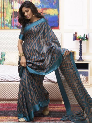 https://static2.cilory.com/398603-thickbox_default/lt-fabrics-teal-printed-saree.jpg
